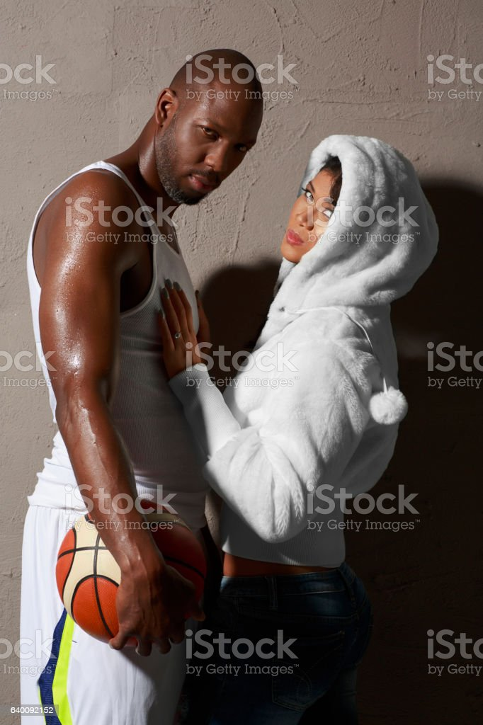 Relationship African American Couple  women and men basketball player stock photo