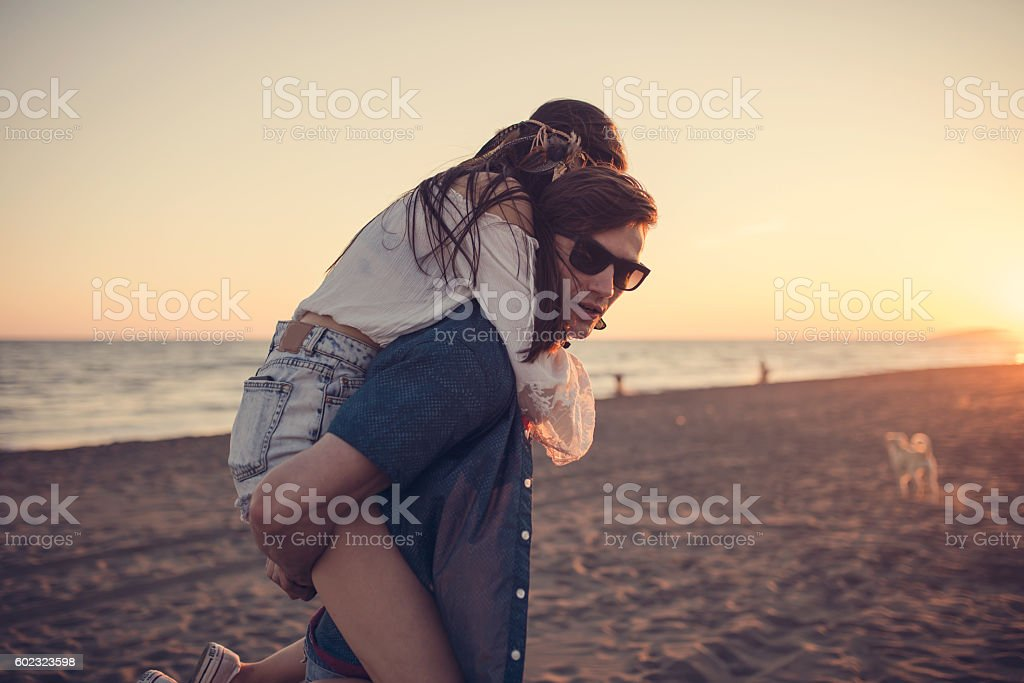 Relationship goals on the beach, sunset stock photo