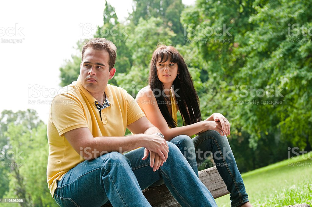 Relationship problems - couple in park royalty-free stock photo