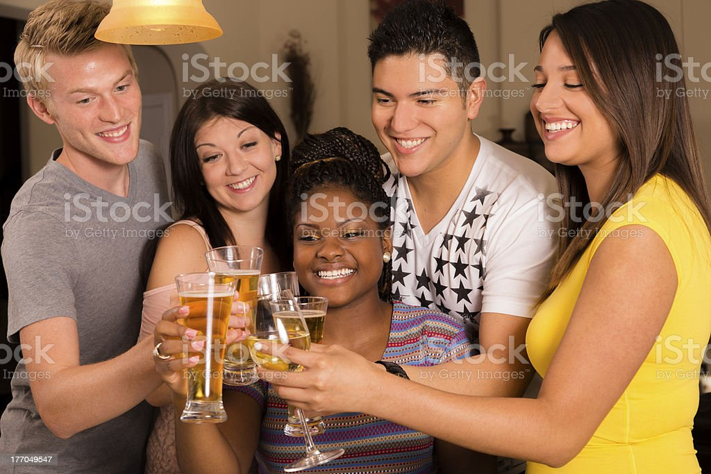 Relationships:  Multi-ethnic group enjoying drinks together. royalty-free stock photo