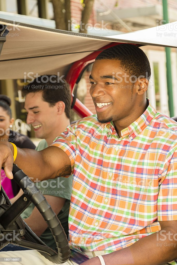 Relationships:  Young adult friends visiting by jeep in downtown USA. royalty-free stock photo