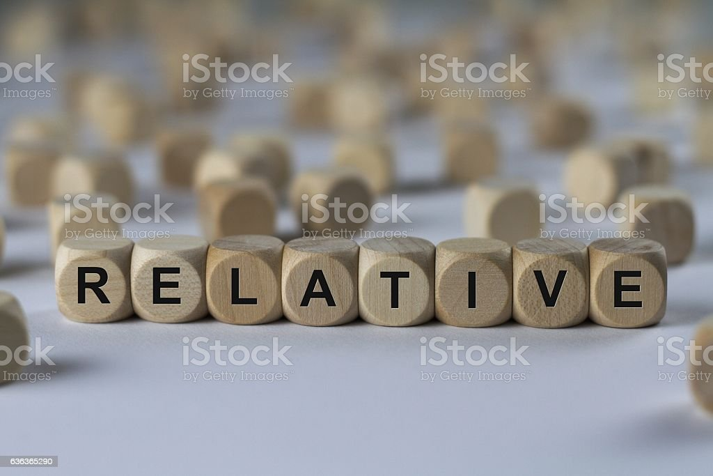 relative - cube with letters, sign with wooden cubes stock photo