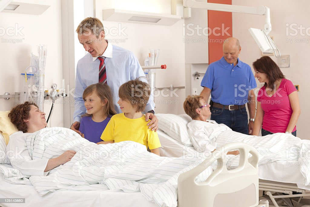 relatives visiting patients in hospital stock photo