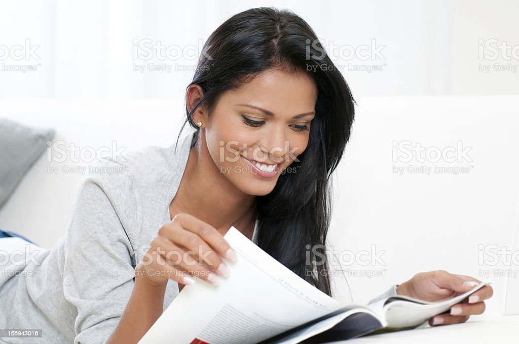 Relax at home with magazine stock photo