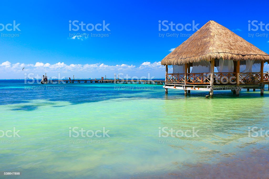 Relax: beach palapa thatched roof - Cancun, caribbean tropical paradise stock photo