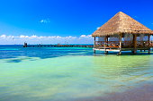 Relax: beach palapa thatched roof - Cancun, caribbean tropical paradise