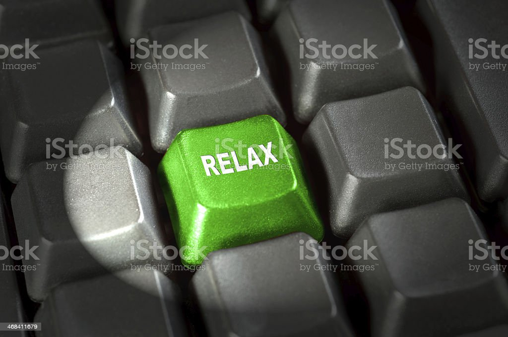 Relax concept - key on keyboard in light beam stock photo
