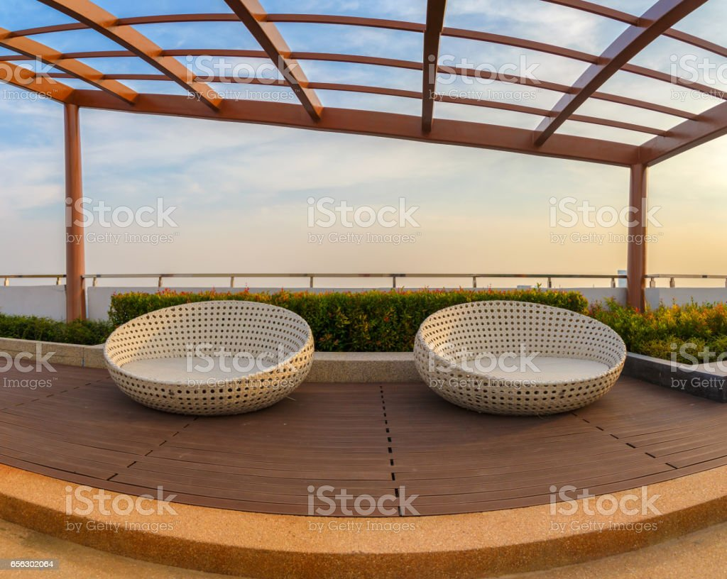 Relax corner on condominium rooftop garden with chairs. stock photo