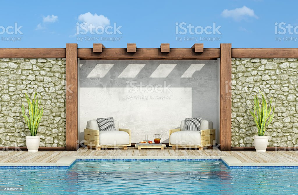 Relax in a garden with swimming pool stock photo
