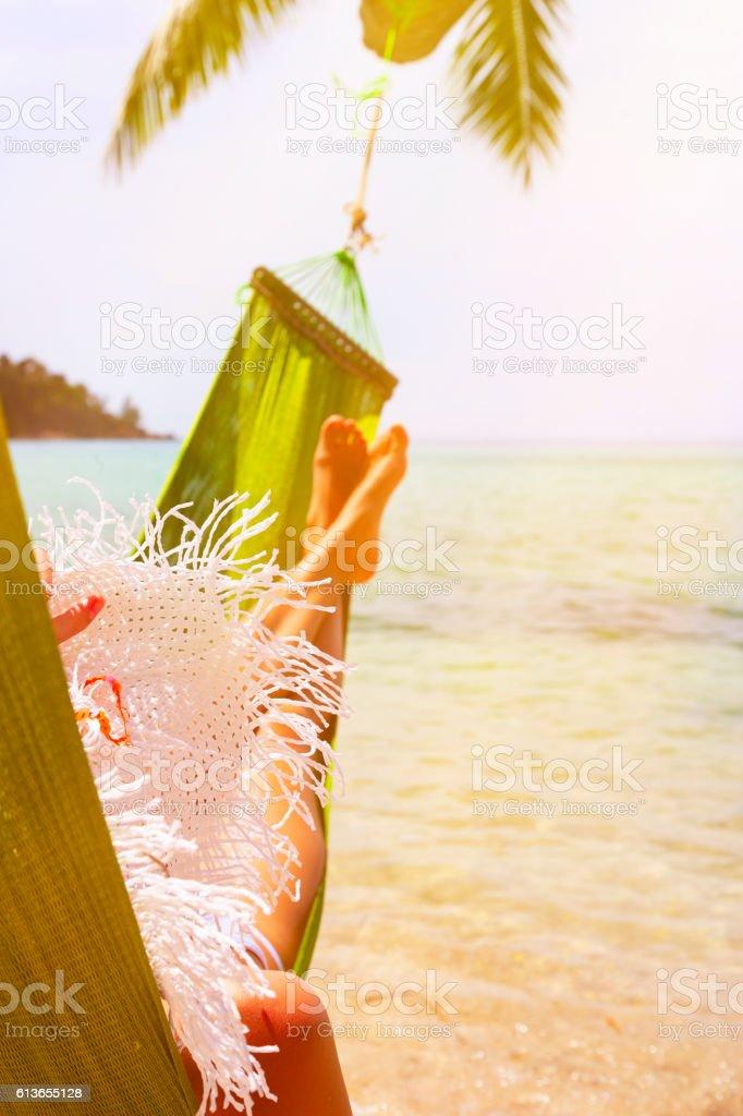 Relax in beach hammock stock photo