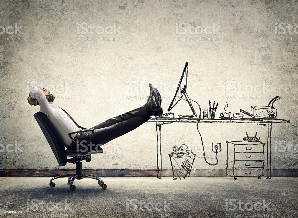 relax in office - businessman in break stock photo