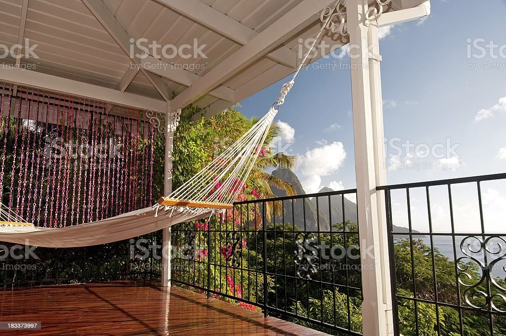 Relax in paradise on perfect hammock stock photo