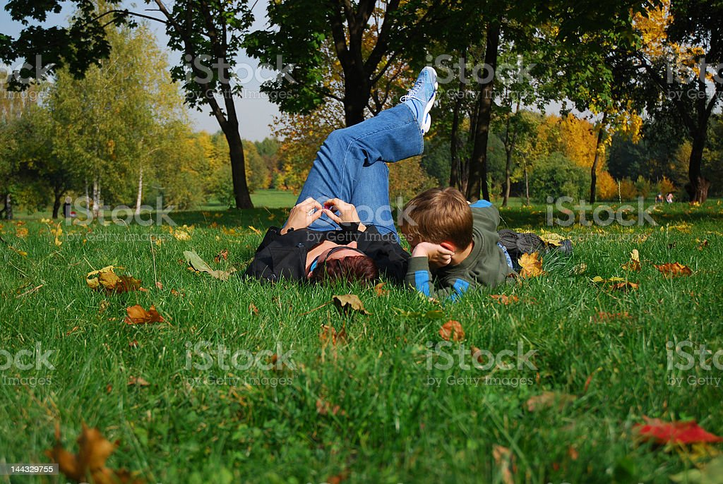 Relax mother and son on meadow royalty-free stock photo