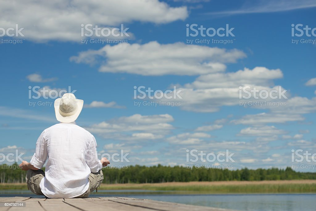 Relax outdoors in a hat stock photo