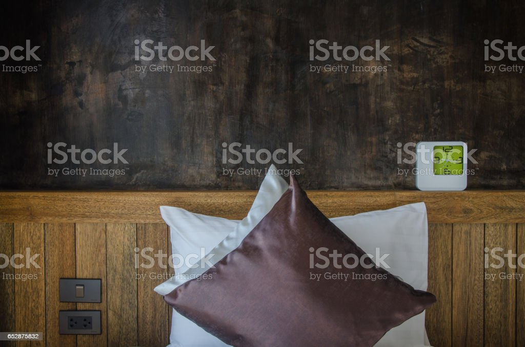relax room with pillow and alarm clock stock photo