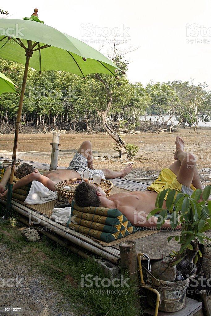 relax thai tourists on the beach royalty-free stock photo