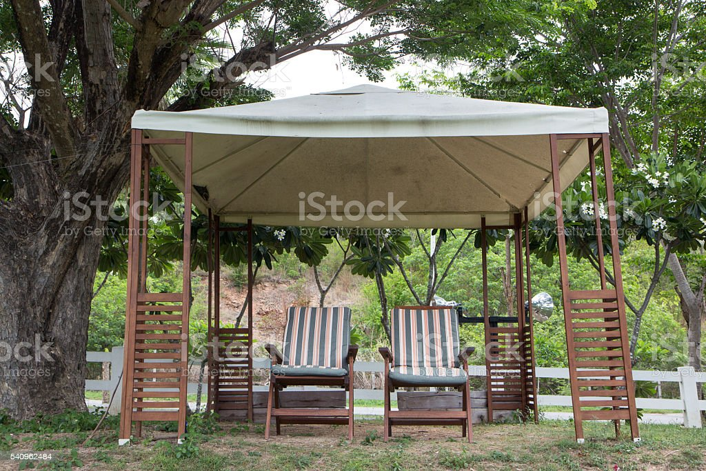relax two chairs in party tent for picnic in garden Стоковые фото Стоковая фотография