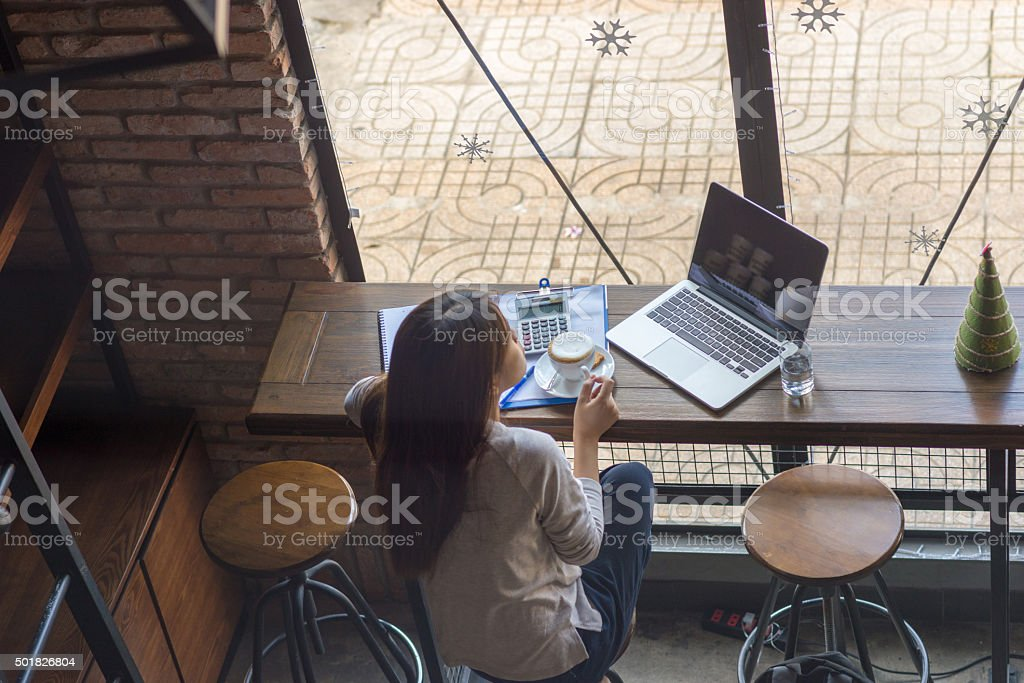 Relax with a cup of coffee after working too hard stock photo