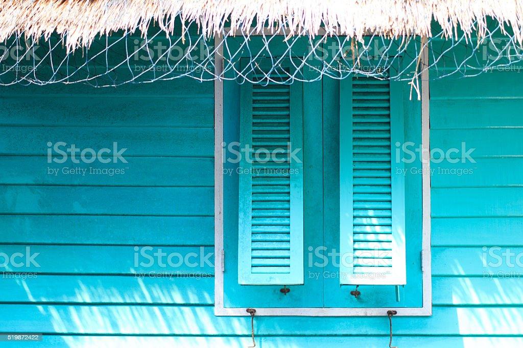 Расслабьтесь с голубой дом в море, отдых время Стоковые фото Стоковая фотография