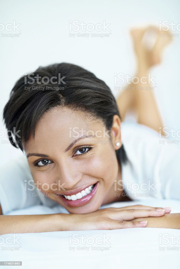 Relaxation and rest brings a smile to her face royalty-free stock photo