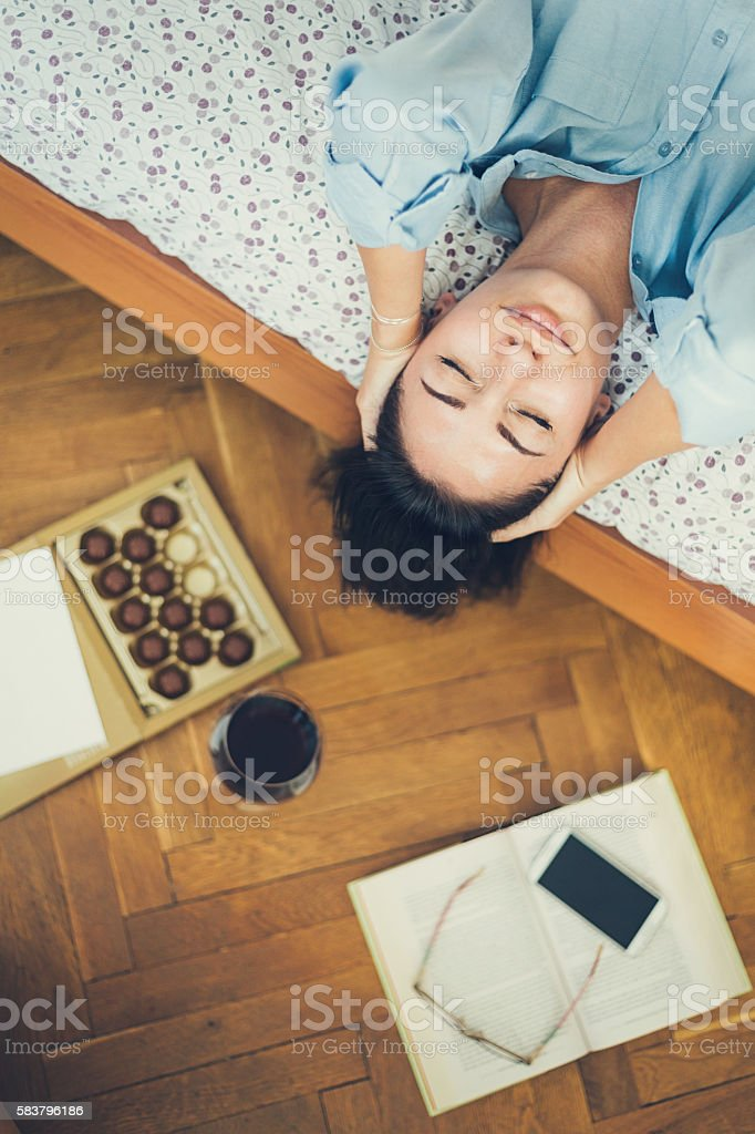 Relaxation at home with wine and treats stock photo