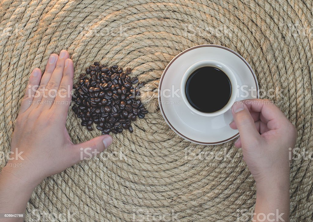 Relaxation drink coffee on a jute rope. stock photo