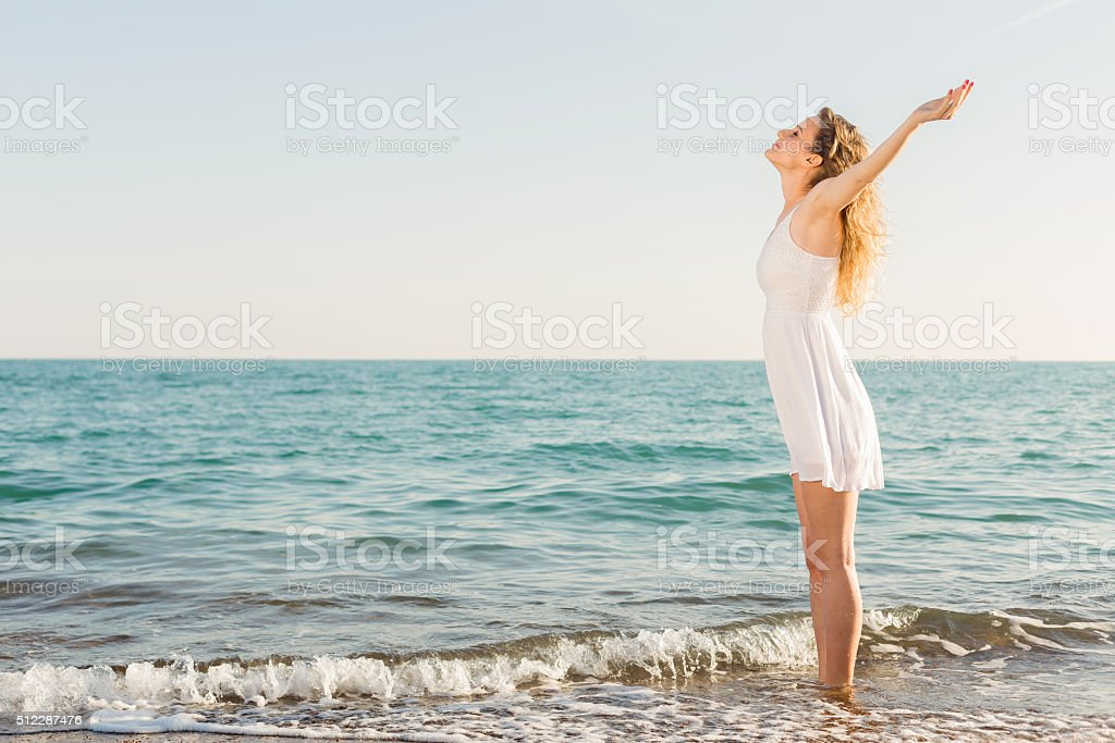 Relaxation exercise on the beach stock photo