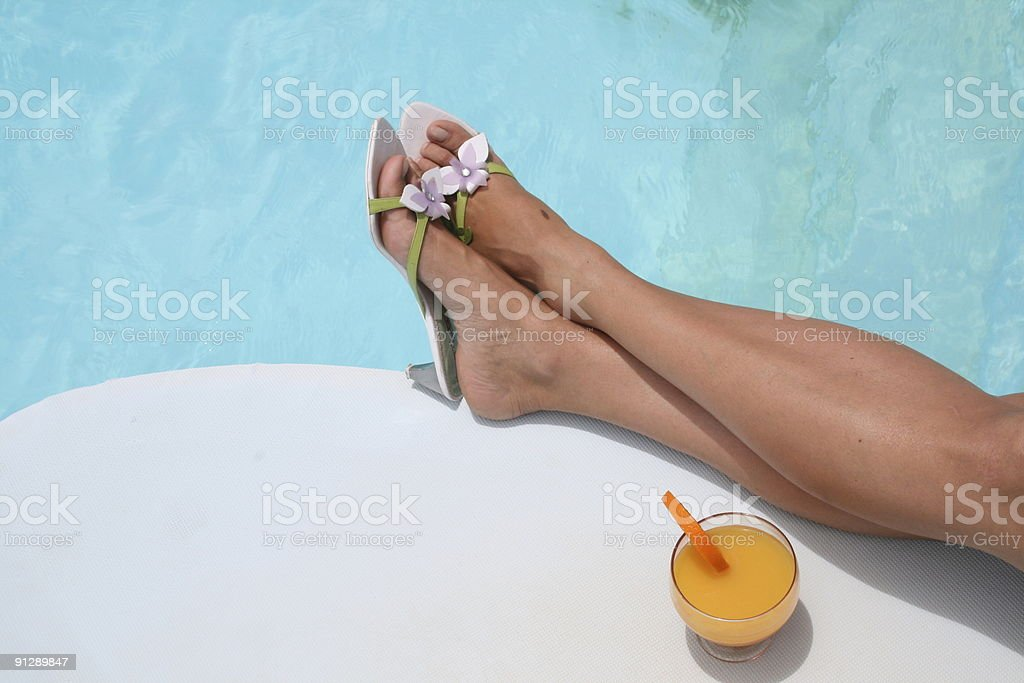 Relaxation near pool royalty-free stock photo