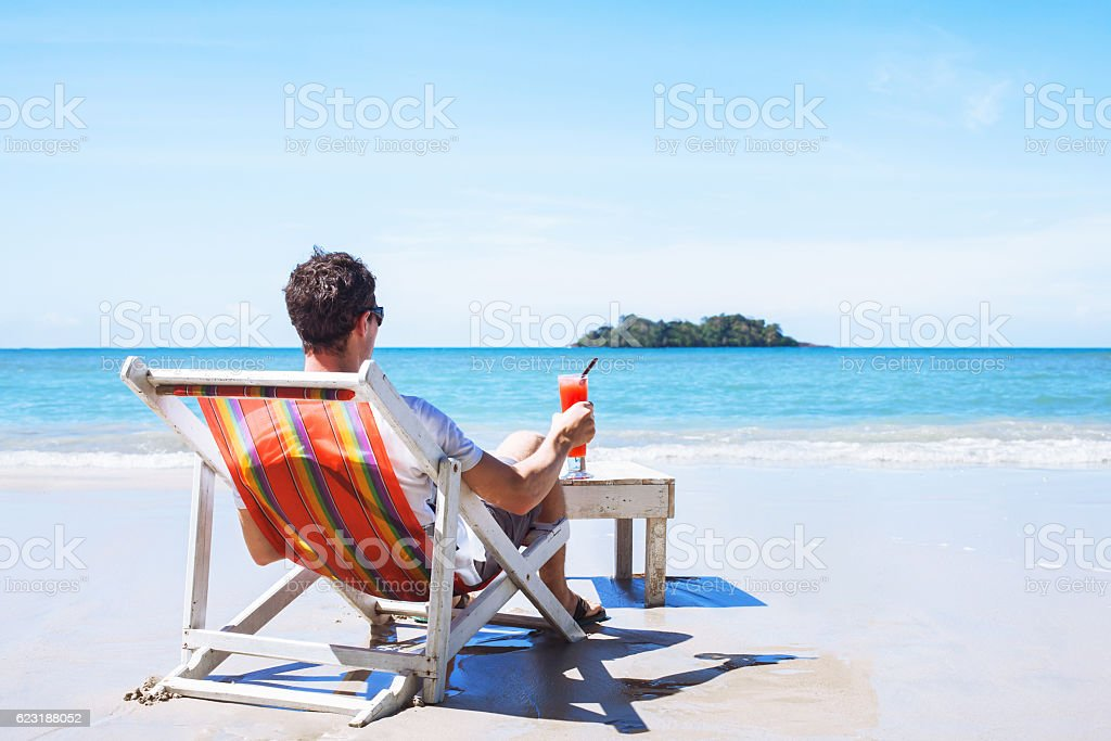 relaxation, tourist with cocktail, beach holidays stock photo