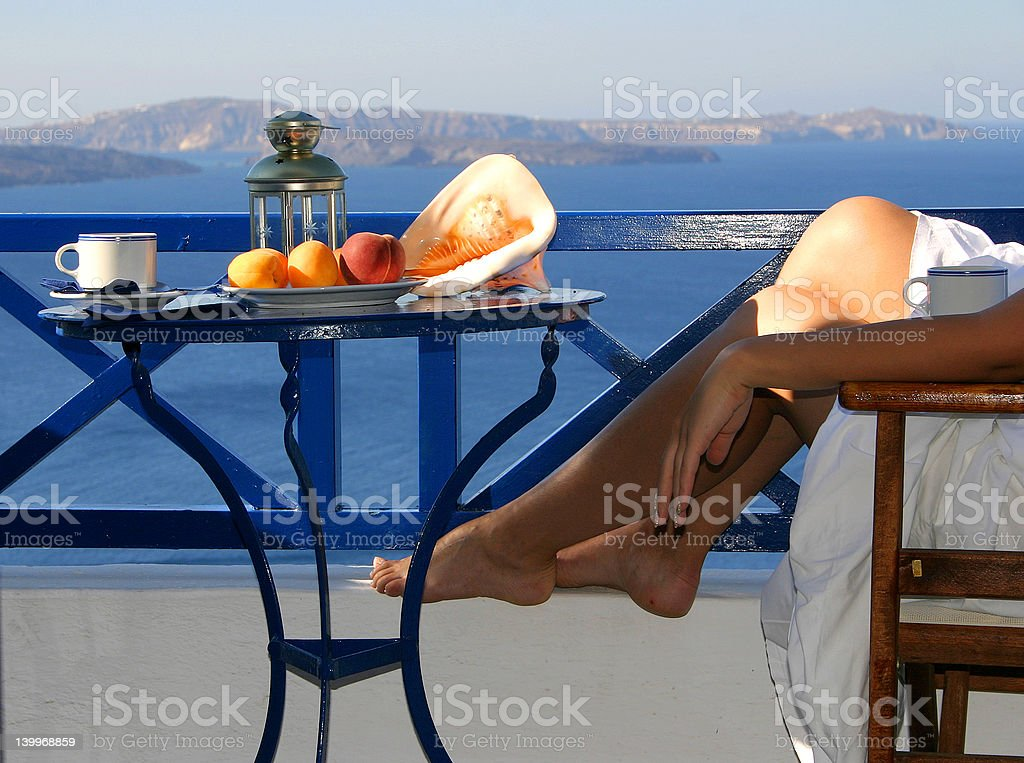 Relaxation with a seaview and fruit plate royalty-free stock photo