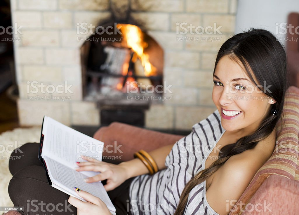 Relaxation with book and fire royalty-free stock photo