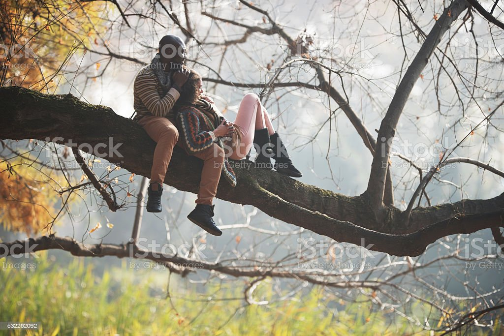 Relaxed African American couple spending a day in autumn park. stock photo