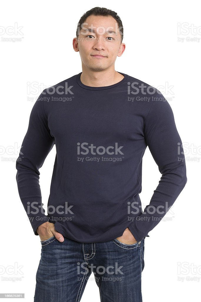 Relaxed Asian Man With Hands in Pockets stock photo