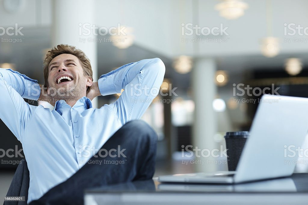 Relaxed business man laughing stock photo
