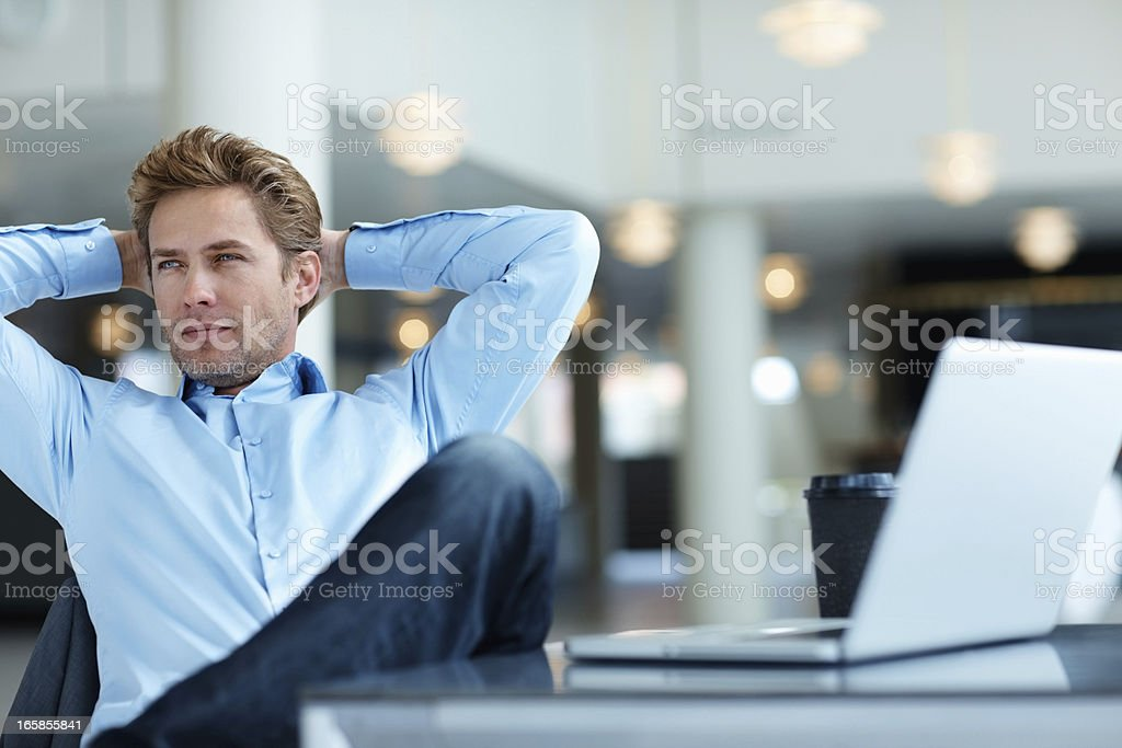 Relaxed business man thinking stock photo