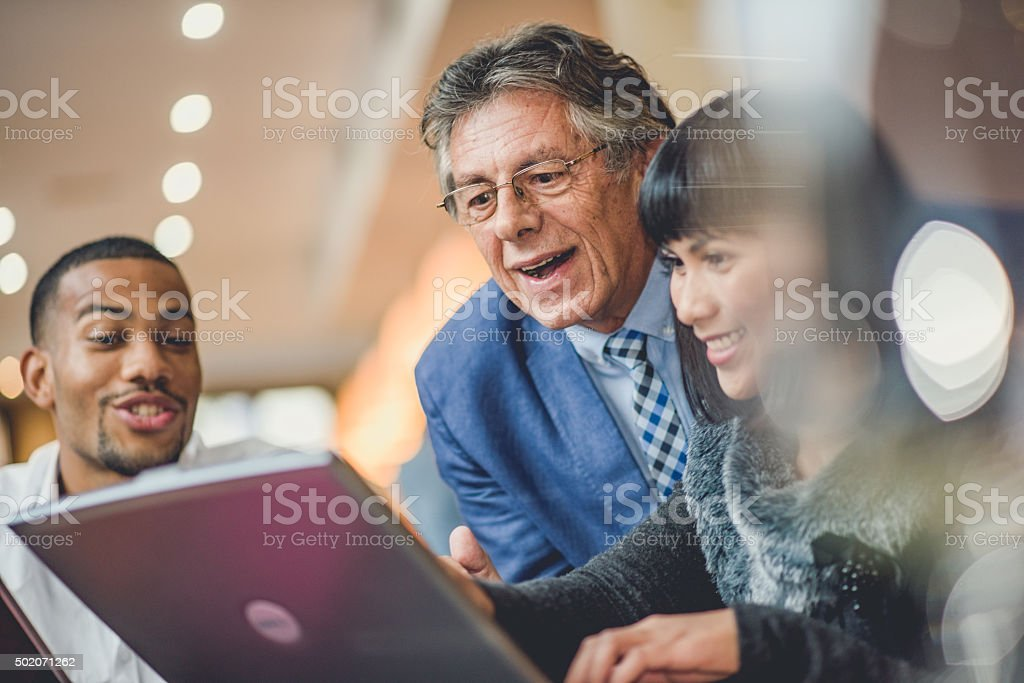 Relaxed business team office meeting stock photo