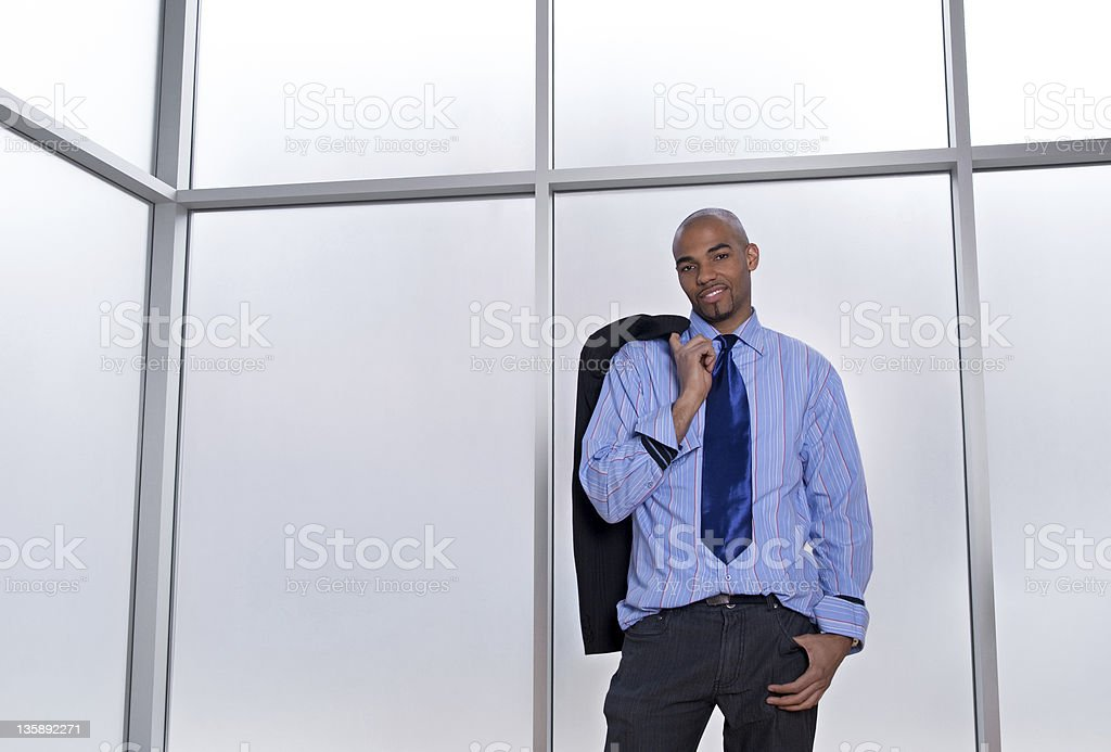Relaxed businessman beside a big office window royalty-free stock photo