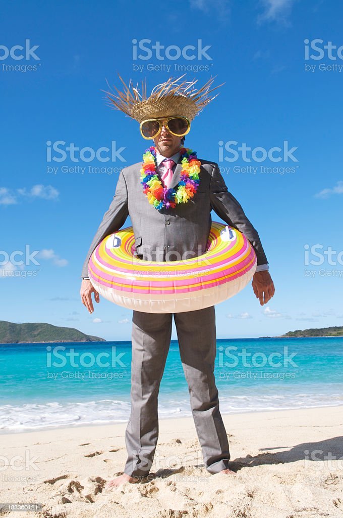 Relaxed Businessman in Full Tourist Gear Standing on Tropical Beach royalty-free stock photo