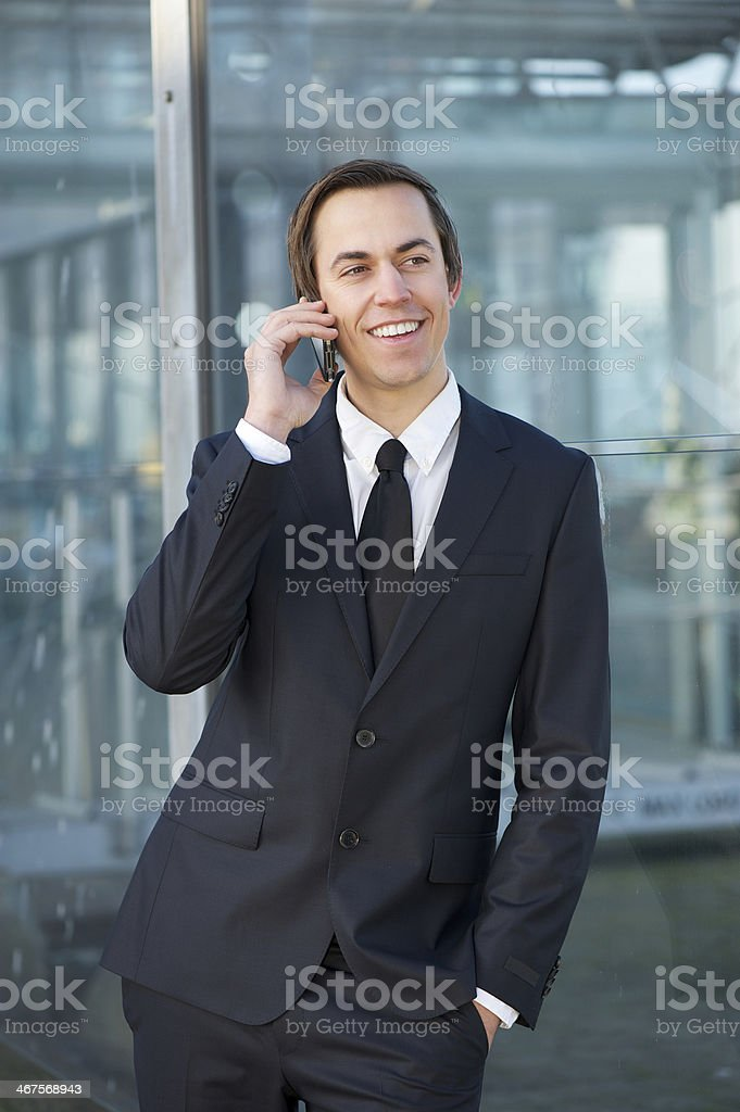 Relaxed businessman smiling and talking on mobile phone royalty-free stock photo