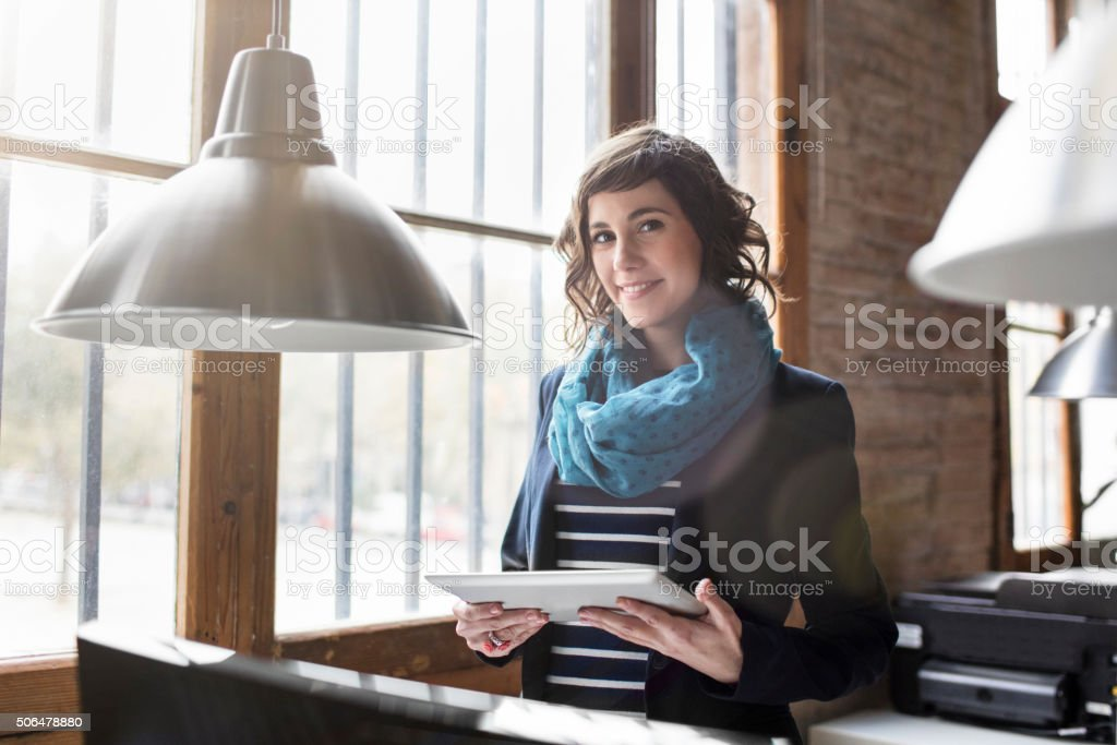 Relaxed businesswoman at the office stock photo