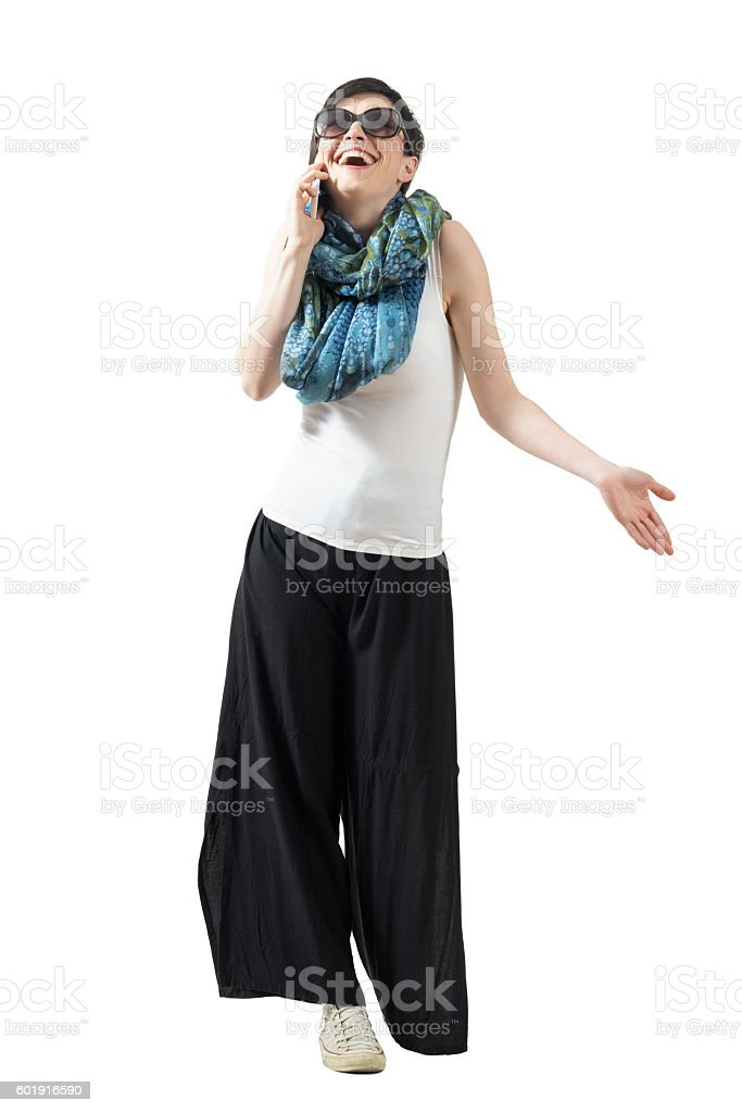 Relaxed casual woman on the phone laughing looking up stock photo