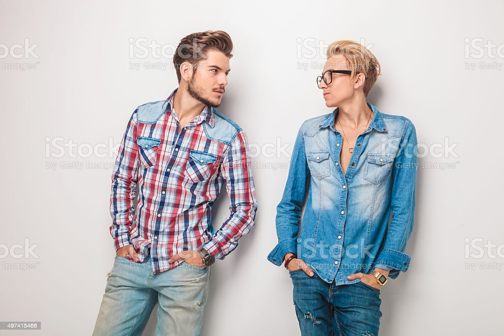 relaxed casual young men looking at eachother stock photo
