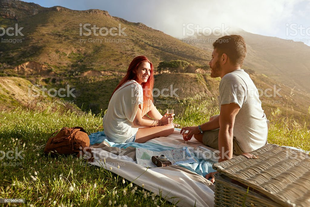 Relaxed couple enjoying romantic picnic in the countryside stock photo