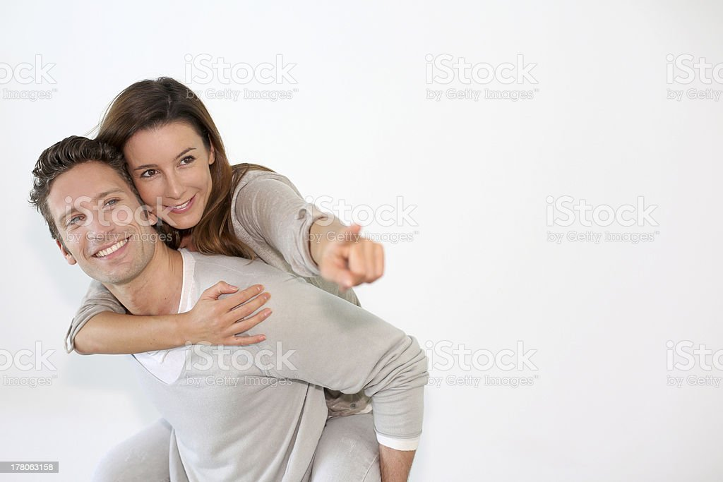 Relaxed couple looking towards the camera royalty-free stock photo