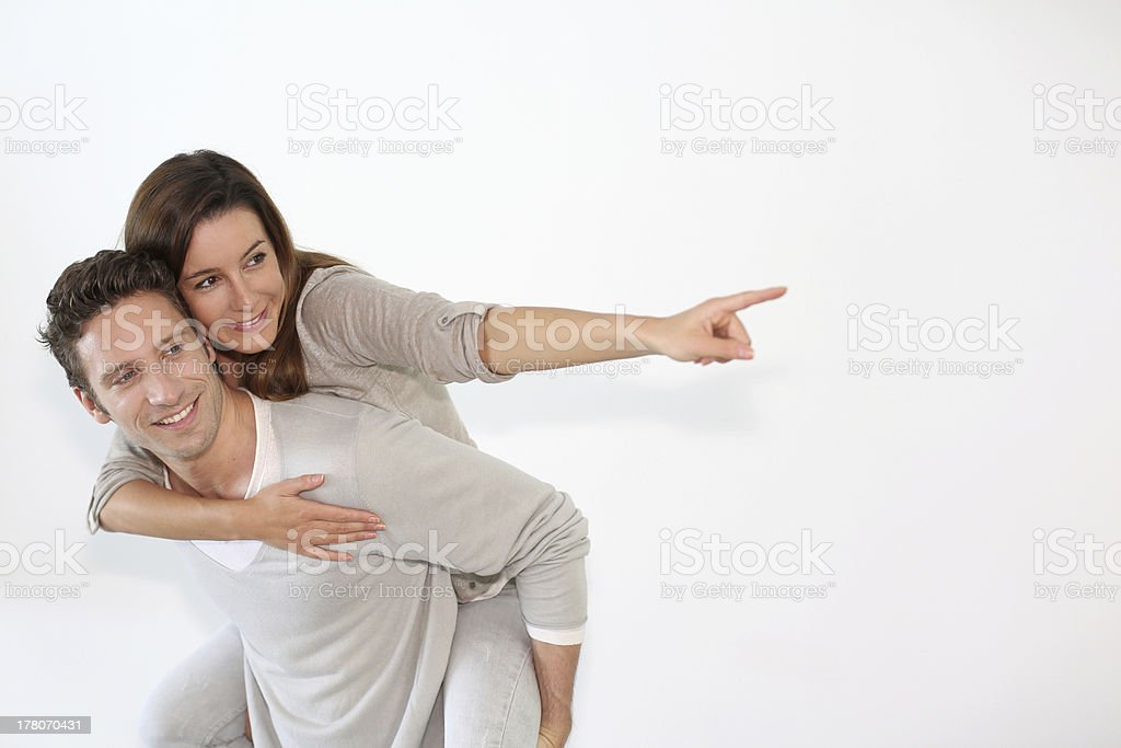 Relaxed couple looking towards their future royalty-free stock photo