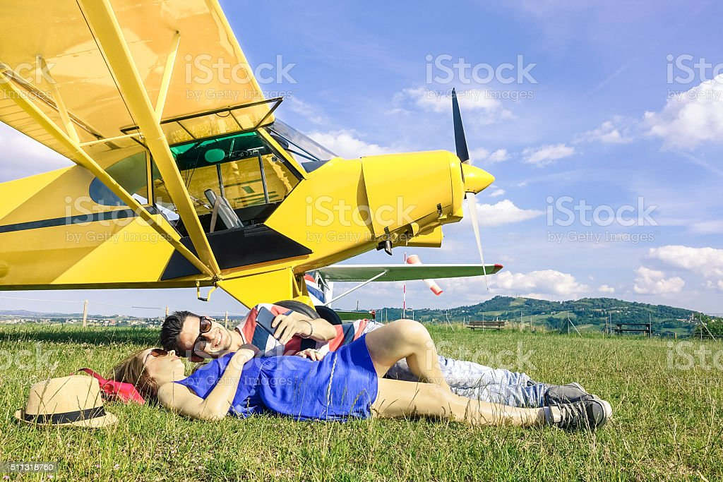 Relaxed couple of lovers having a rest during airplane travel stock photo