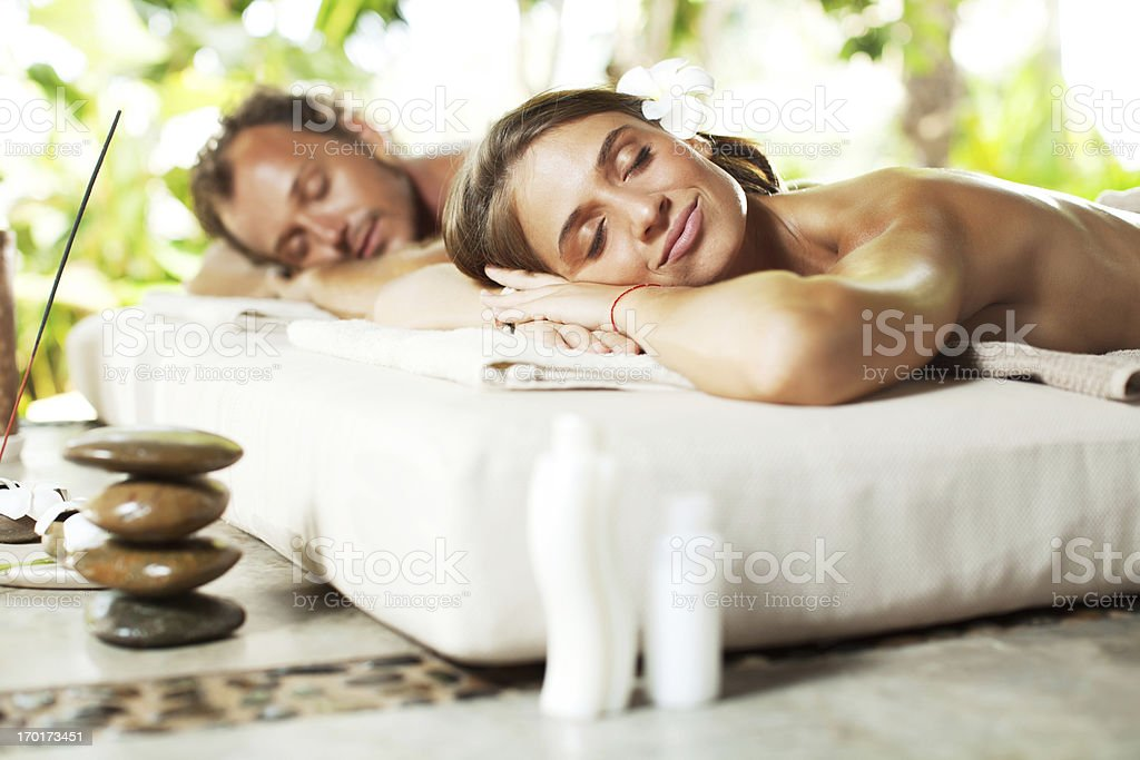Relaxed couple receiving hot stone therapy. royalty-free stock photo