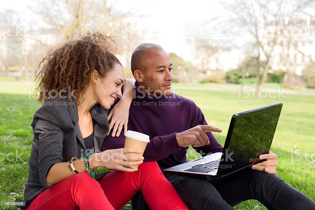 relaxed couple sitting in the park royalty-free stock photo