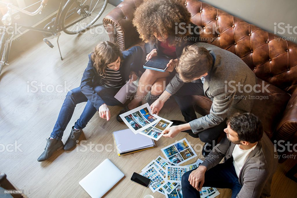 Relaxed creative people brainstorming in the office stock photo