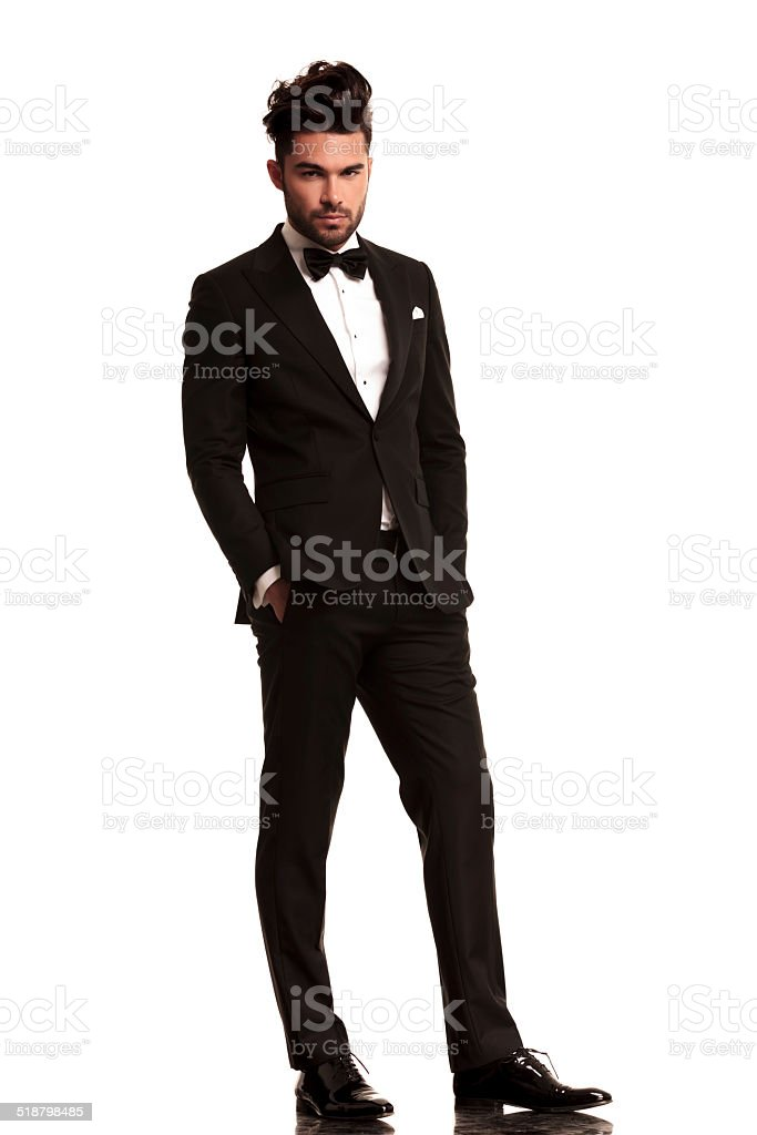 relaxed elegant man in tuxedo stock photo